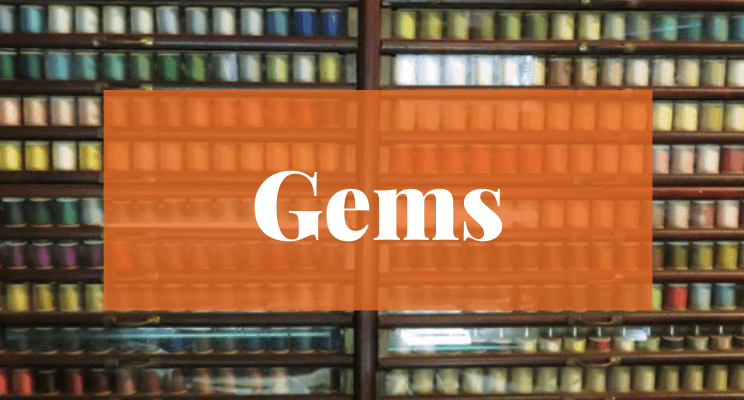 Spools of sewing thread. Text: Gems