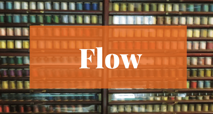 Spools of sewing thread. Text: Flow